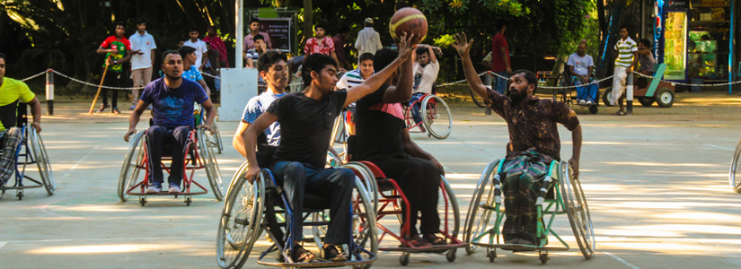 photo of wheelchair athletes playing basketball