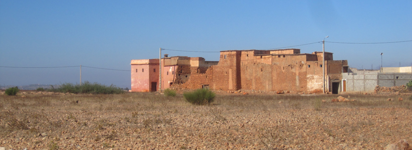 photo of old desert buildings from a distance