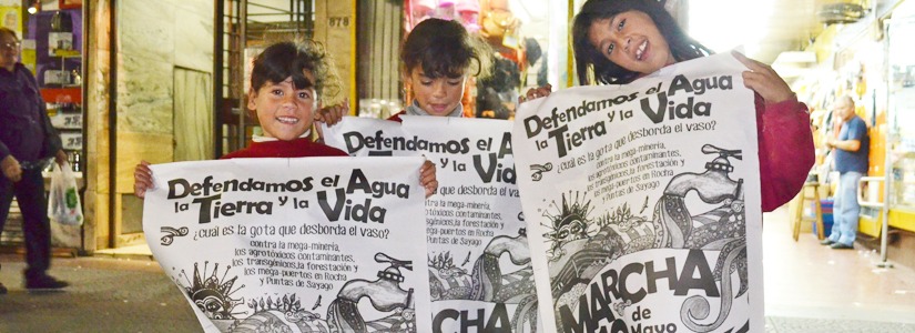 photo of three young people holding posters