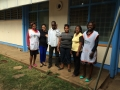 photo of Julie Farzana with a group of Kenyans in front of a building